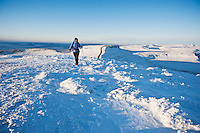 Single female hiker of Snow covered summit of Pen Y Fan, Brecon Beacons national park, Wales