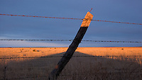 Fencepost, sunrise, Russell Springs, Kan., Dec. 7, 2006.
