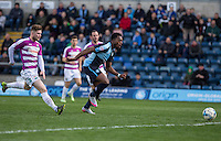 Gozie Ugwu of Wycombe Wanderers chases down the ball during the Sky Bet League 2 match between Wycombe Wanderers and Barnet at Adams Park, High Wycombe, England on 16 April 2016. Photo by Andy Rowland.