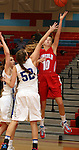 SIOUX FALLS, SD: DECEMBER 14: Anna Brecht #10 from Lincoln takes the ball to the basket against Marissa Hirchert #52 from Rapid City Stevens in the second half of their game Saturday afternoon at Lincoln. (photo by Dave Eggen/Inertia)