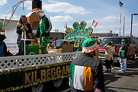People wait before the start of the parade to march in the 2013 annual St. Patrick's Day Parade in South Boston, Boston, Massachusetts, USA.