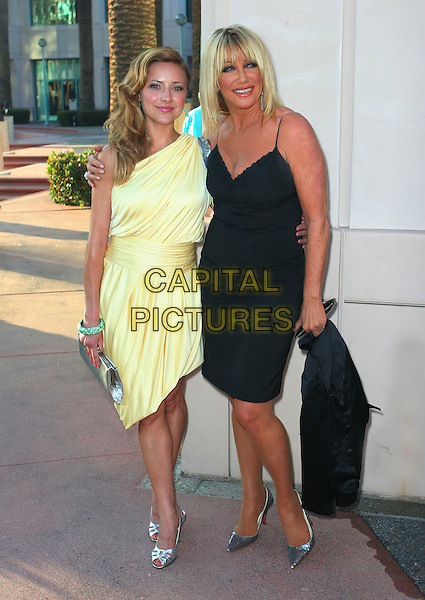 """CHRISTINE LAKIN & SUZANNE SOMERS .""""A Father's Day Salute to TV Dads""""  held at Leonard  H. Goldenson Theater, North Hollywood, California, USA..June 18th, 2009.full length yellow dress silver clutch bag shoes green bracelet black.CAP/ADM/TC.©T. Conrad/AdMedia/Capital Pictures."""