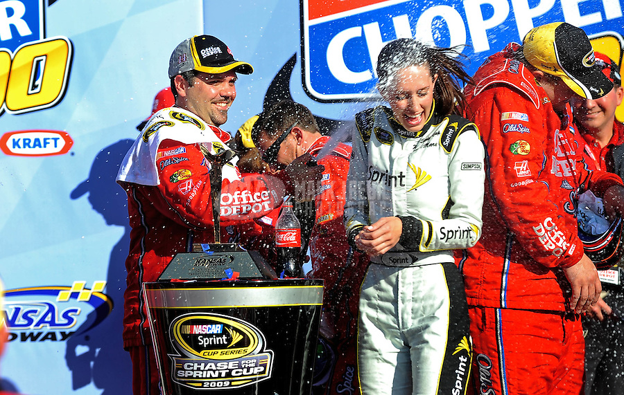 Oct. 4, 2009; Kansas City, KS, USA; NASCAR Sprint Cup Series crew chief Darian Grubb sprays Anne-Marie Rhodes with champagne in victory lane during the Price Chopper 400 at Kansas Speedway. Mandatory Credit: Mark J. Rebilas-