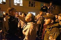 Pictured: Police officers against an angry mob in Monkton, Pembrokeshire, Wales, UK. Tuesday 11 July 2017<br /> Re: A riot broke out in a quiet country village when more than 200 protesters threw stones and lit fires outside the house of a woman they suspected of being a sex offender.<br /> The angry mob shouting 'paedo' and 'nonce' were broken up by at about 4am when the 24-year-old woman and another person were escorted from the house by armed police.<br /> The crowd had gathered in Monkton, Pembrokeshire just after 9pm on Tuesday night after a series of sex allegations against the woman were made on Facebook.