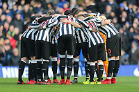 The Newcastle United team in a huddle before the Premier League match between Chelsea and Newcastle United at Stamford Bridge, London, England on 2 December 2017. Photo by David Horn.