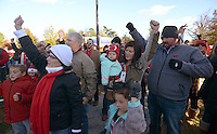 NWA Democrat-Gazette/BEN GOFF @NWABENGOFF<br /> Tailgaters call the hogs while watching the Razorback Band and pom squad on Saturday Nov. 21, 2015 before the Arkansas football game against Mississippi State in Fayetteville.