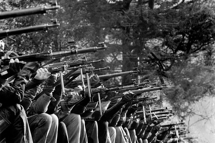 "Switzerland. Canton Uri. Rütli. Twenty competitors and members of the riflemen's association aim their rifles and automatic or semi-automatic assault rifles SG 550 during the Rütlischiessen. Rütli or Grütli is a mountain meadow overlooking the lake Lucerne where the oath of the Rütlischwur for the forming of the Old Swiss Confederacy is said to have occurred as the legendary turning-point in the pursuit of independence. To commemorate this historic event, the riflemen's association of Lucerne organized the Rütli rifle match (Rütlischiessen) in 1862. It is held every year on the Wednesday before Martinmas (Saint Martin's Day). Thousand competitors from all over Switzerland fire their fifteen shots at targets arranged on a cliff. The SG 550 is an assault rifle manufactured by Swiss Arms AG (formerly Schweizerische Industrie Gesellschaft) of Neuhausen, Switzerland. ""SG"" is an abbreviation for Sturmgewehr, or ""assault rifle"". The rifle is based on the earlier 5.56mm SG 540 and is also known as the Fass 90 or Stgw 90. An assault rifle is a selective-fire rifle that uses an intermediate cartridge and a detachable magazine. 9.11.2016 © 2016 Didier Ruef"