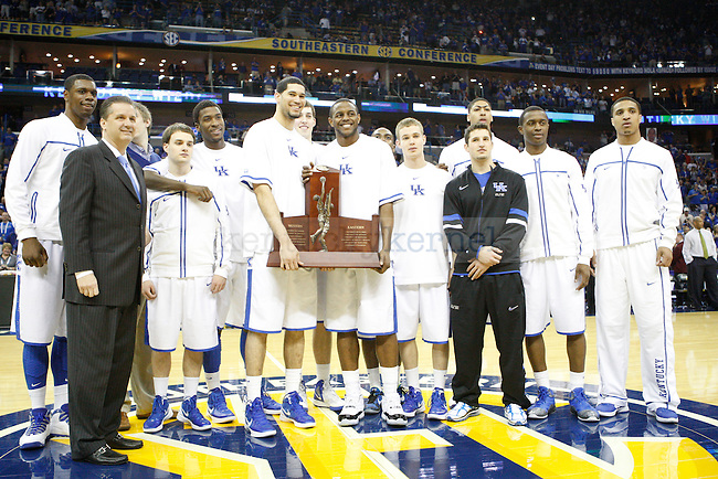 The UK Men's basketball team accepts the trophy for winning the SEC regular season champion title before the first half in the 2012 SEC Tournament game between Kentucky and LSU, played at the New Orleans Arena, on 3/9/12.  Photo by Quianna Lige | Staff