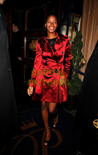 JAMELIA.At the Black Entertainment TV Launch Party, Cafe de Paris, London, England,.March 1st 2008..full length red satin trench coat belted mac.CAP/CAN.?Can Nguyen/Capital Pictures