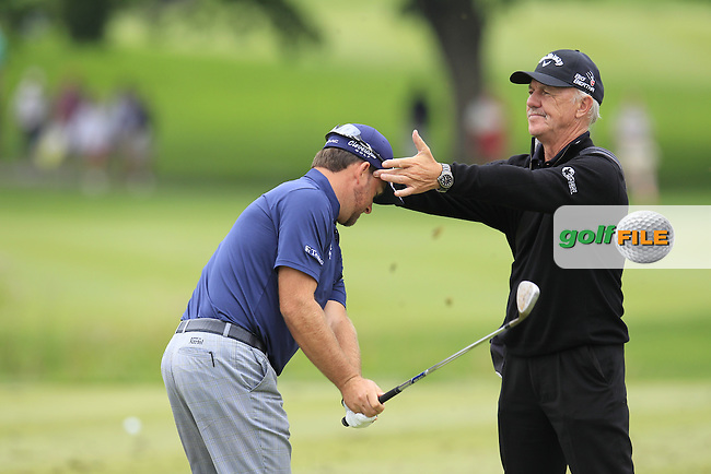 Graeme McDOWELL (NIR) working with Pete Cowan on the range during Wednesday's Practice Day of the WGC Bridgestone Invitational, held at the Firestone Country Club, Akron, Ohio.: Picture Eoin Clarke, www.golffile.ie: 30th July 2014
