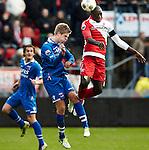 Nederland, Utrecht, 2 december  2012.Eredivisie.Seizoen 2012-2013.FC Utrecht-AZ.Jacob Mulenga van FC Utrecht in duel om de bal met Markus Henriksen van AZ