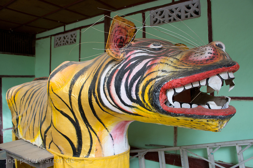 sculpture of a tiger, building outside Nanpaya temple, village Myinkaba , Bagan archeological site, Myanmar, 2011.  Huge tiger sculptures like this usually guard shrines with Nat spirit figures.