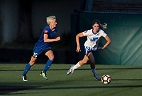 Seattle, WA - Saturday July 15, 2017: Megan Rapinoe, Christen Westphal during a regular season National Women's Soccer League (NWSL) match between the Seattle Reign FC and the Boston Breakers at Memorial Stadium.