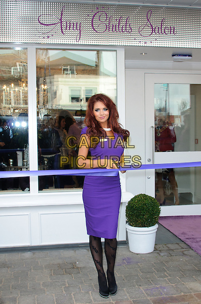 Amy Childs.Towie star, Amy Childs opens her own Salon in her hometown of Brentwood..Brentwood, England - 24.11.11.November 24th, 2011.full length purple dress  silver belt ribbon black pattern tights cutting scissor necklace .CAP/CJ.©Chris Joseph/Capital Pictures.