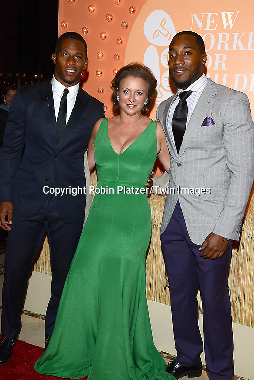Victor Cruz and Mario Manningham &amp; Barbara Hemmerle Gollust attends the New Yorkers for Children 15th Annual Fall Gala to Benefit Youth in Foster Care which is presented by Chloe and David Yurman at Cipriani 42nd Street on September 30,2014 in New York City. <br /> <br /> photo by Robin Platzer/Twin Images<br />  <br /> phone number 212-935-0770