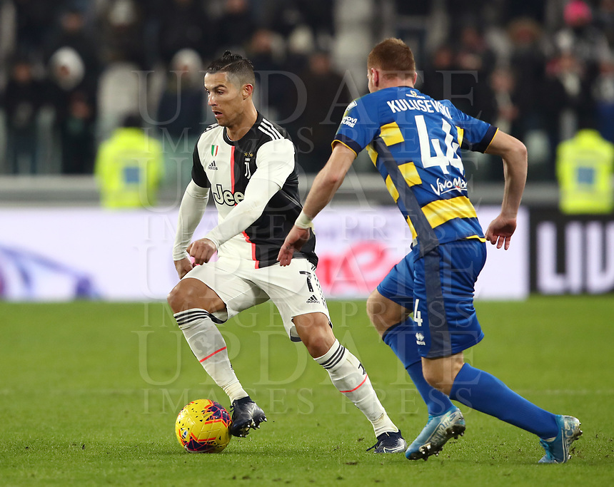 Calcio, Serie A: Juventus - Parma, Turin, Allianz Stadium, January 19, 2020.<br /> Juventus' Cristiano Ronaldo (l) in action with Parma's Dejan Kulusevski (r) during the Italian Serie A football match between Juventus and Parma at the Allianz stadium in Turin, January 19, 2020.<br /> UPDATE IMAGES PRESS/Isabella Bonotto