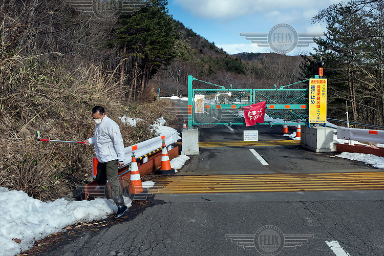 A Greenpeace activist measuring radioactivity at one of the checkpoints that give access to the restricted area near the Fukushima nuclear reactor.  On 11 March 2011 a magnitude 9 earthquake struck 130 km off the coast of Northern Japan causing a massive tsunami that swept across the coast of Northern Honshu damaging the Fukushima Daiichi nuclear power plant and triggering the worst nuclear accident since Chernobyl. The plant was shut down and a 20 km evacuation zone around the plant was declared by the government. Levels of radiation in the evacuation zone remain high.