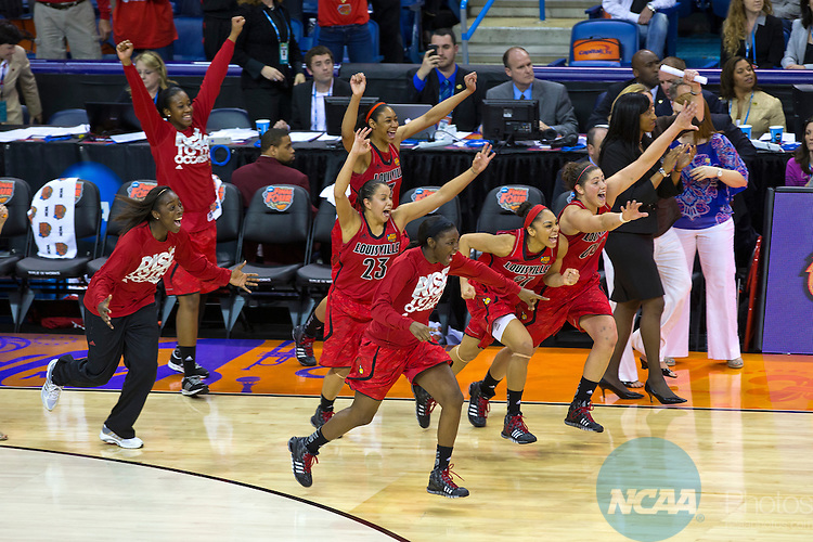 07 APR 2013:  The Louisville Cardinal women's basketball team celebrates its victory against the University of California during the national semi-final game at the Division I Women's Basketball Championship in New Orleans, LA.  The Cardinals defeated The Golden Bears 64-57 to advance to the finals. Matt Marriott/NCAA Photos