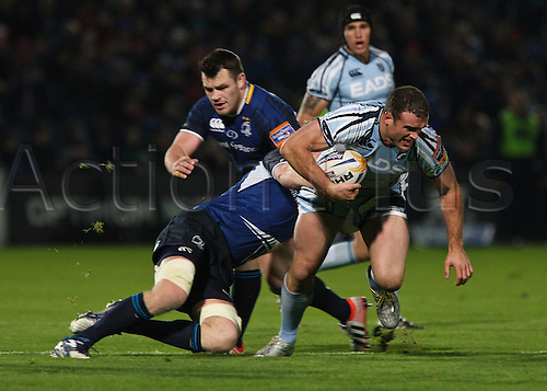 .27.10.2012 Dublin, Ireland.Jamie Roberts goes to ground,under the challenge, of Leo Cullen (Capt), during the RaboDirect PRO12 game between Leinster and Cardiff Blues from the Royal Dublin Society.