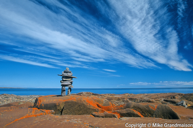 Inukshuk on rocky shore of Hudson Bay<br /> Churchill<br /> Manitoba<br /> Canada