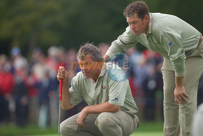 Straffin Co Kildare Ireland. K Club Ruder Cup...European Ryder Cup team members Lee Westwood and Darren Clarke line up thier putt on the 18th green on the opening fourball session on the first day of the 2006 Ryder Cup, at the K Club in Straffan, Co Kildare, in the Republic of Ireland, 22 September 2006..Photo: Eoin Clarke/ Newsfile.<br />