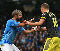2nd November 2019; Etihad Stadium, Manchester, Lancashire, England; English Premier League Football, Manchester City versus Southampton; Sergio Aguero of Manchester City is closely marked by James Ward-Prowse of Southampton - Strictly Editorial Use Only. No use with unauthorized audio, video, data, fixture lists, club/league logos or 'live' services. Online in-match use limited to 120 images, no video emulation. No use in betting, games or single club/league/player publications