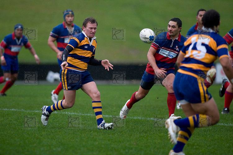 Kane Hancy gets the pass away to Tino Halalilo. CMRFU Counties Power 2008 Club rugby McNamara Cup Premier final between Ardmore Marist & Patumahoe played at Growers Stadium, Pukekohe on July 26th.  Ardmore Marist won 9 - 8.