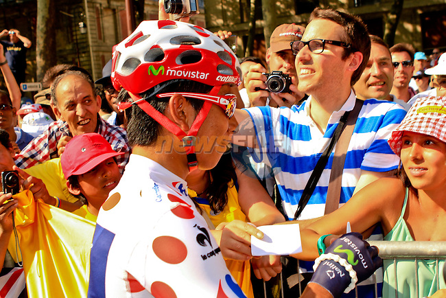 Polka Dot Jersey leader Nairo Alexander Quintana (COL) Movistar Team signs autographs before the start of the Final Stage 21 of the 100th Edition of the 2013 Tour de France from Versailes to Paris Champs-Elysees. 21st July 2013.<br /> (Photo:Thomas van Bracht / Peloton Photos/www.newsfile.ie)