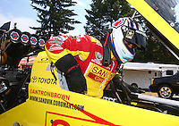 Aug. 2, 2014; Kent, WA, USA; NHRA top fuel dragster driver Antron Brown during qualifying for the Northwest Nationals at Pacific Raceways. Mandatory Credit: Mark J. Rebilas-