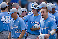 Mike Cavasinni #11 of the North Carolina Tar Heels is congratulated by his teammates after scoring the tying run in the top of the 9th inning versus the Clemson Tigers at Durham Bulls Athletic Park May 23, 2009 in Durham, North Carolina. The Tigers defeated the Tar Heals 4-3 in 11 innings.  (Photo by Brian Westerholt / Four Seam Images)