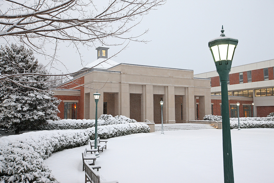 Snow falls over School of Law at the University of Virginia in Charlottesville, VA.