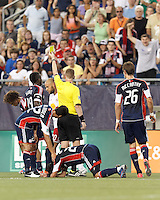 Frustrated New York Red Bulls midfielder Joel Lindpere (20) receives a yellow card warning after decking New England Revolution midfielder Lee Nguyen (24). In a Major League Soccer (MLS) match, New England Revolution defeated New York Red Bulls, 2-0, at Gillette Stadium on July 8, 2012.