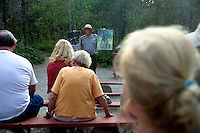A park ranger delivers a talk on the dangers posed by bears in Glacier National Park at the Many Glacier campground in Glacier National Park in Montana.