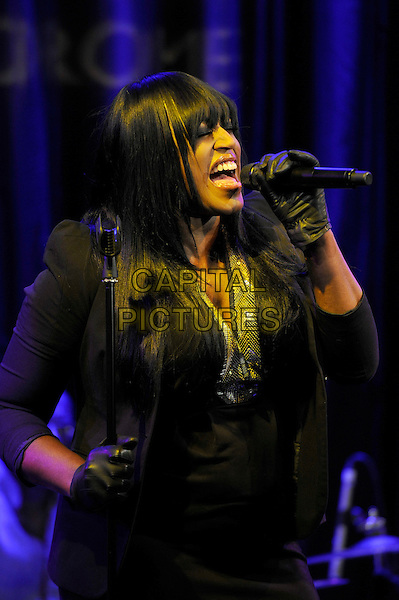 Mica Paris.Performing live in concert, Matcham Room, Hippodrome Casino, London, England, UK, 1st December 2012..music gig on stage half length black dress jacket microphone singing leather gloves .CAP/MAR.© Martin Harris/Capital Pictures.