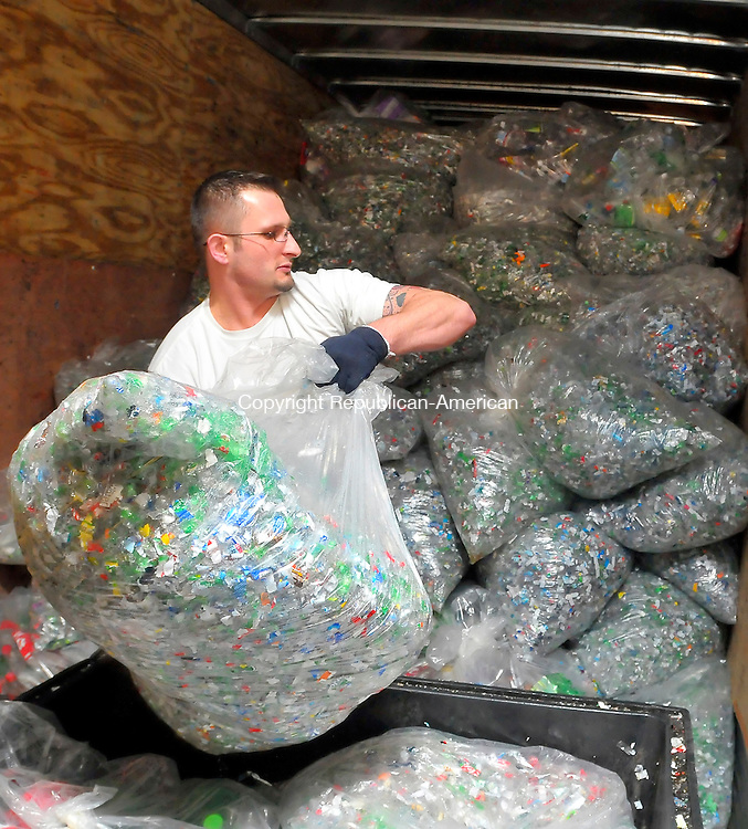 NAUGATUCK, CT-05 FEBRUARY 2009-020510JS11- Julian Gadomski, the night shift manager at Envipco in Naugatuck, loads bags of shredded plastic bottles into the back of a trailer at the plant on Friday. The company makes recycling machines for bottles and cans at grocery stores and processes the bottles and cans. <br /> Jim Shannon Republican-American