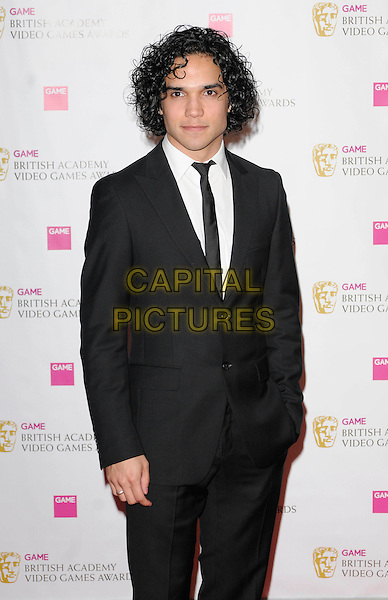 REECE RITCHIE .The Game BAFTA Video Game Awards, Hilton Hotel, Park Lane, London, England, UK, 16th March 2011..half length black suit tie white shirt .CAP/CAN.©Can Nguyen/Capital Pictures.