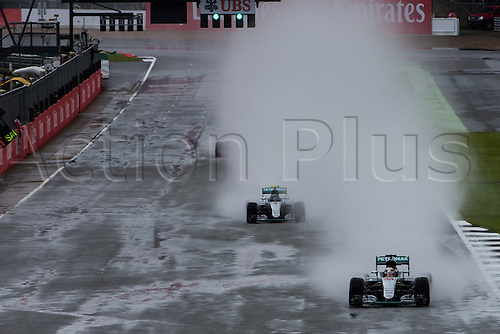 10.07.2016. Silverstone, England. Formula One British Grand Prix, race day.  Spray pours off the wet track as Mercedes AMG Petronas Formula One Team driver Lewis Hamilton leads.