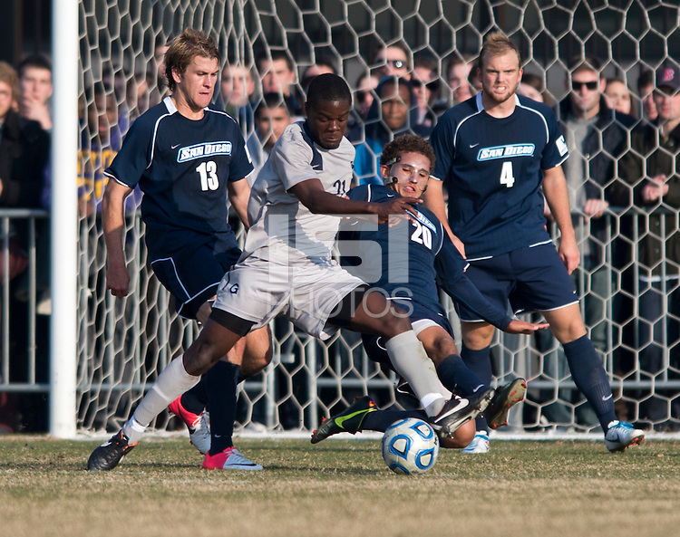 Melvin Snoh (21) of Georgetown has the ball tackled away from him by Christian Duke (20) of San Diego during the game at North Kehoe Field in Washington, DC.  Georgetown defeated San Diego, 3-1.