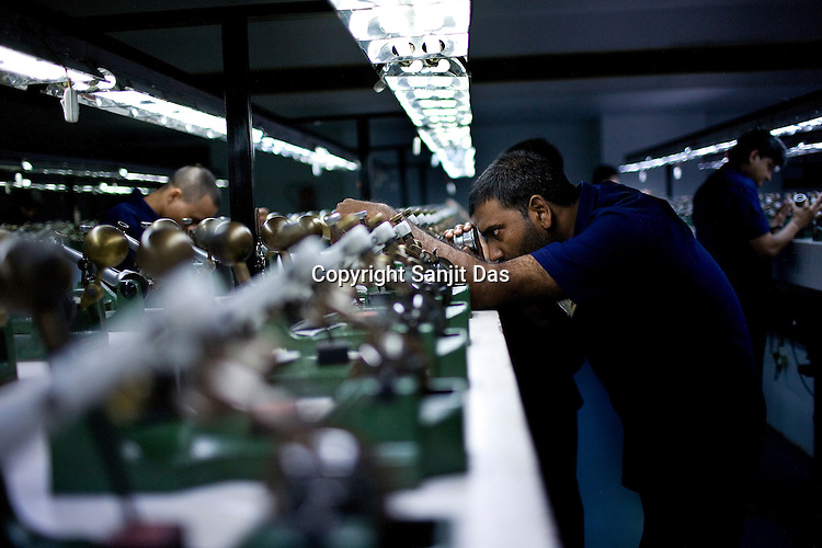 Diamond specialists check the shapes of the rough diamonds in the sowing section at the sowing and polishing factory in Surat, Gujarat, Western India.