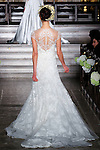 Model walks runway in a Yasmin bridal gown from the Atelier Pronovias 2014 collection by Pronovias, at St. James' Church in New York City, on November 12, 2013.