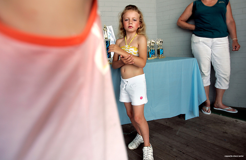 McKayla Sanborn, center, 8, of Dover, has her game face on before the start of The 2nd Little/Junior Miss Hampton Beach Pageant at Hampton Beach Sunday, Aug. 16,  2009.  (Portsmouth Herald Photo Cheryl Senter)