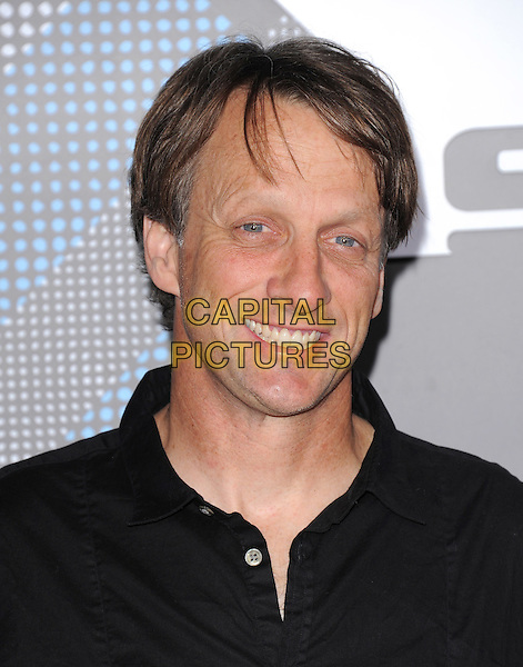 TONY HAWK.at The T-Mobile Sidekick 4G Launch Party held at a private lot in Beverly Hills, California, USA, April 20th 2011..portrait headshot  black shirt   smiling                                                                              .CAP/RKE/DVS.©DVS/RockinExposures/Capital Pictures.