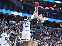 Washington, DC - March 11, 2018: Davidson Wildcats forward Peyton Aldridge (23) takes a shot over Rhode Island Rams guard Stanford Robinson (13) during the Atlantic 10 championship game between Rhode Island and Davidson at  Capital One Arena in Washington, DC.   (Photo by Elliott Brown/Media Images International)