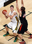 RAPID CITY, S.D.-- MARCH 21, 2015:  Zane Hammerich #50 of Aberdeen Roncalli goes up against the defense of  Ben Hammer #44 of Dell Rapids during their championship game at the 2015 South Dakota  State A Boys Basketball Tournament at the Don Barnett Arena in Rapid City Saturday. (Photo by Dick Carlson/Inertia)