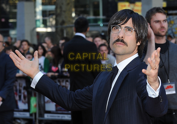 JASON SCHWARTZMAN .at the UK premiere of 'Scott Pilgrim Vs. The World' held at the Empire cinema, Leicester Square, London, England, 18th August 2010..Arrivals half length hands arms gesture black tie navy blue pinstripe glasses white shirt mustache moustache facial hair .CAP/BEL.©Tom Belcher/Capital Pictures.