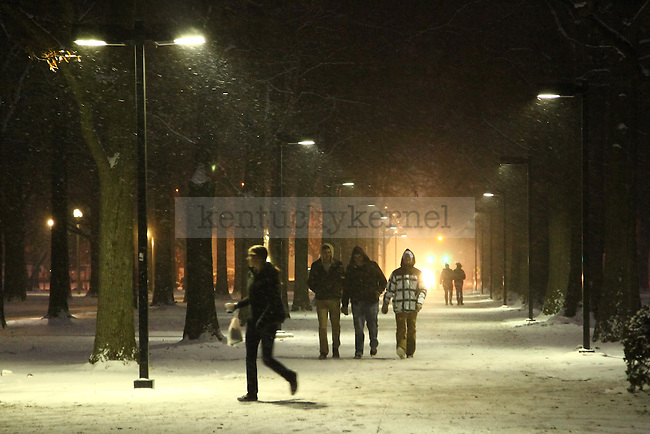 Students walk along the path from Univerversity Drive to South campus Tuesday evening. Photo by Brandon Goodwin | Staff.