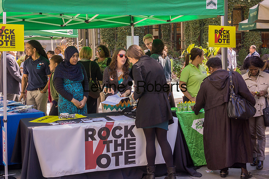 Members of Rock the Vote celebrate National Voter Registration Day in Bryant Park in New York on Tuesday, September 24, 2013. Tables were set up and numerous groups enticed the non-registered to register to vote. (© Richard B. Levine)