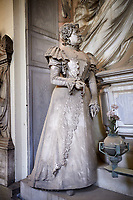 Picture and image of the stone sculpture in Borgeoise Realistic style of the Rossi family tomb. The monumental tombs of the Staglieno Monumental Cemetery, Genoa, Italy