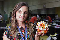 OrigamiUSA 2014 exhibition. Isa Klein holding one of her modular origami creations