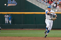 UCLA shortstop Pat Valaika (10) makes a throw to first base during Game 12 of the 2013 Men's College World Series against the North Carolina Tar Heels on June 21, 2013 at TD Ameritrade Park in Omaha, Nebraska. The Bruins defeated the Tar Heels 4-1, to reach the CWS Final and eliminate North Carolina from the tournament. (Andrew Woolley/Four Seam Images)